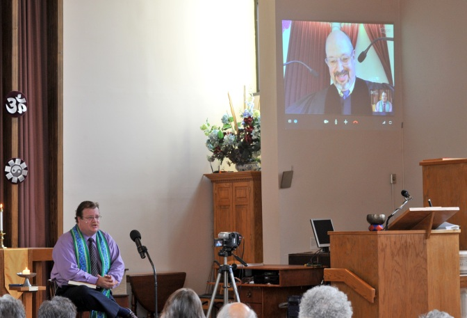 SHOOT DATE: OCT. 2, 2011 - Association Sunday - Unitarian Universalist Church of Worcester (Mass.)  At left, Rev. Aaron Payson.  At right, on screen, Rev. Tom Schade, First Unitarian, Worcester (Mass.)
